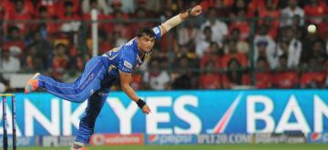 Rajasthan Royals bowler Pravin Tambe in action during 35th match of IPL 2014 between Rajasthan Royals and Royal Challengers Bangalore at  M Chinnaswamy Stadium in Bangalore on May 11, 2014. (Photo: IANS)