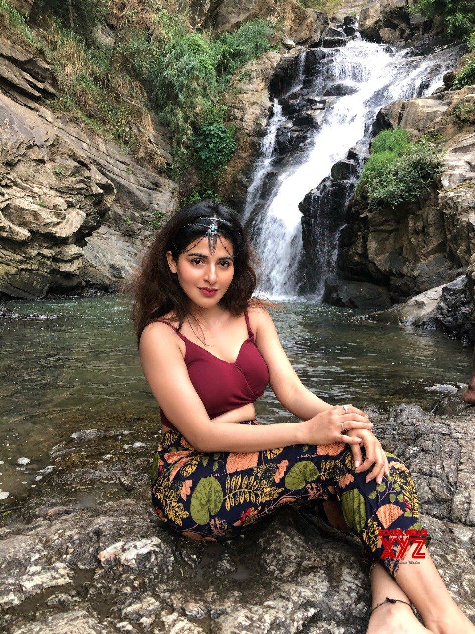 Actress Iswarya Menon Sizzling Stills From A Photoshoot Shot Near A Waterfall