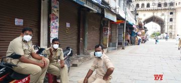 Hyderabad: Police personnel deployed near Charminar where shops remained closed in the wake of increasing number of COVID-19 cases, in Hyderabad on July 3, 2020. (Photo: IANS)