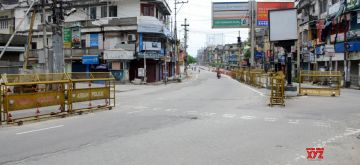 Guwahati:  A Guwhatai road bears a deserted look after the district administration re-imposed lockdown for 14-days in 11 wards in Guwahati following a huge surge in the number of Covid-19 cases in the city, on July 3, 2020. (Photo: IANS)