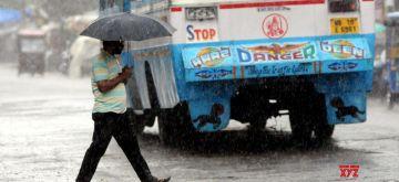 Kolkata: People use umbrellas to shield themselves during rains, in Kolkata on July 5, 2020. (Photo: Kuntal Chakrabarty/IANS)
