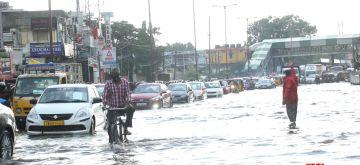 Chennai: Vehicles wade through a water-logged road after heavy rains lashed Chennai, on July 28, 2020. (Photo: IANS)