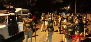 """Bengaluru: Police personnel deployed outside Congress legislator Akanda Srinivas Murthy's house where a mob gathered and shouted slogans over a derogatory post on social media, in Bengaluru on Aug 11, 2020. Violent protests broke out in eastern Bengaluru late on Tuesday night over a """"derogatory message' posted by the politician's relative on social media. (Photo: IANS)"""