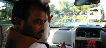 Begusarai: JDU leader Shyam Rajak in his car that was attacked in Begusarai of Bihar on Sept 6, 2018. (Photo: IANS)