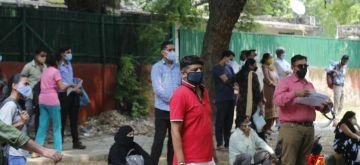 New Delhi: Students moving in the queue at the main gate of  NEET (UG)  Exam center, Bharatiya Vidya Bhawan in New Delhi on September 13, 2020. (Photo: IANS)