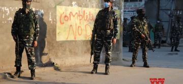 Srinagar: Security personnel during a cordon and search operation after three terrorists were killed and a woman died in an encounter that started at Batmalloo in Srinagar city on Sep 17, 2020. According to details, the firefight between terrorists and security forces took place after security forces laid a cordon and launched a search operation on the basis of a specific information about the presence of terrorists in the area. As the security forces zeroed in on the spot where the terrorists were hiding they came under a heavy volume of fire that triggered the encounter. (Photo: IANS)