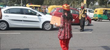 New Delhi: New Delhi district administration officials dressed up as Yamraj (the Hindu God of Death) and Chitragupta (Hindu god assigned with the task of keeping complete records of actions of human beings on the earth and punish or reward them according to their Karmas) fine people with Rs. 500, for not wearing masks, at Connaught place during a campaign to spread awareness on prevention of COVID-19, in New Delhi on Sep 29, 2020. (Photo: IANS)