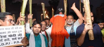 Patna: Jan Adhikar Party (JAP) chief Pappu Yadav leads a torchlight protest march against the Hathras gang rape case, in Patna on Oct 2, 2020. (Photo: IANS)