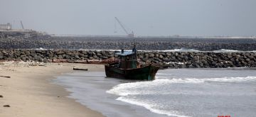 Chennai: A fishing boat stranded along a beach at Kasimedu fishing harbour in Chennai on Oct 16, 2020. (Photo: IANS)