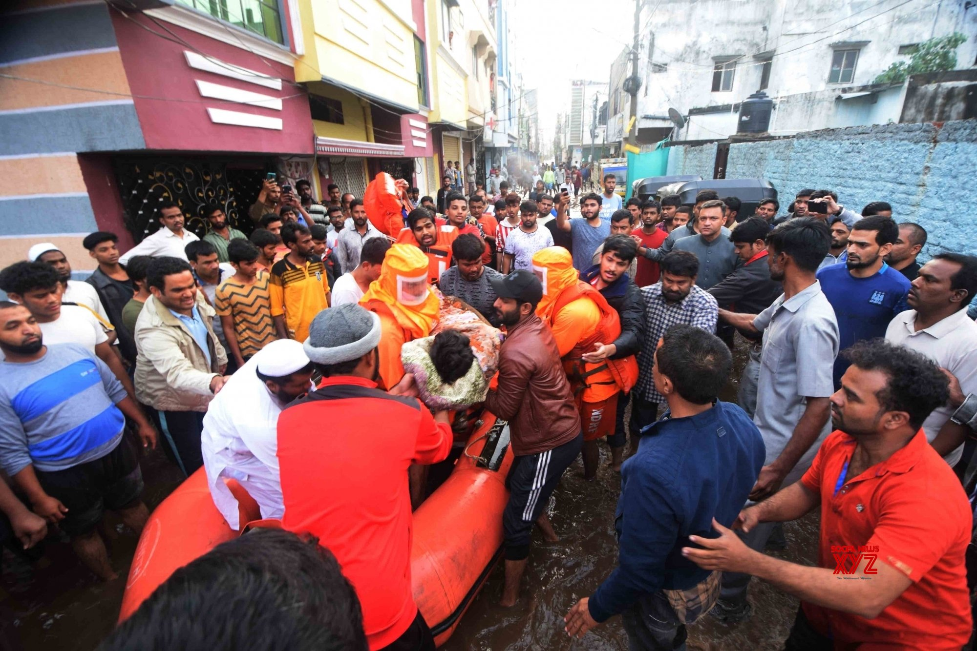 Hyderabad: GHMC team recovers a body in front of AIMIM Floor Leader Akbaruddin Owaisi #Gallery