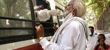 New Delhi: A health worker collects swab samples from people for COVID-19 testing from a mobile testing van in New Delhi on Sep 16, 2020. (Photo: IANS)
