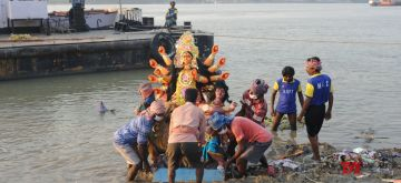 Kolkata: An idol of Goddess Durga being immersed in the Ganga river, in Kolkata on Oct 27, 2020. (Photo: Kuntal Chakrabarty/IANS)