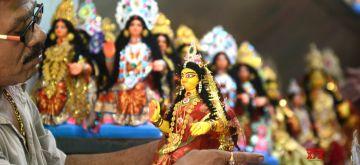 Kolkata: An artist gives finishing touches to an idol of Goddess Laxmi at Kumartuli workshop on the eve of Laxmi Puja celebrations in Kolkata on Oct 29, 2020. (Photo: Kuntal Chakrabarty/IANS)