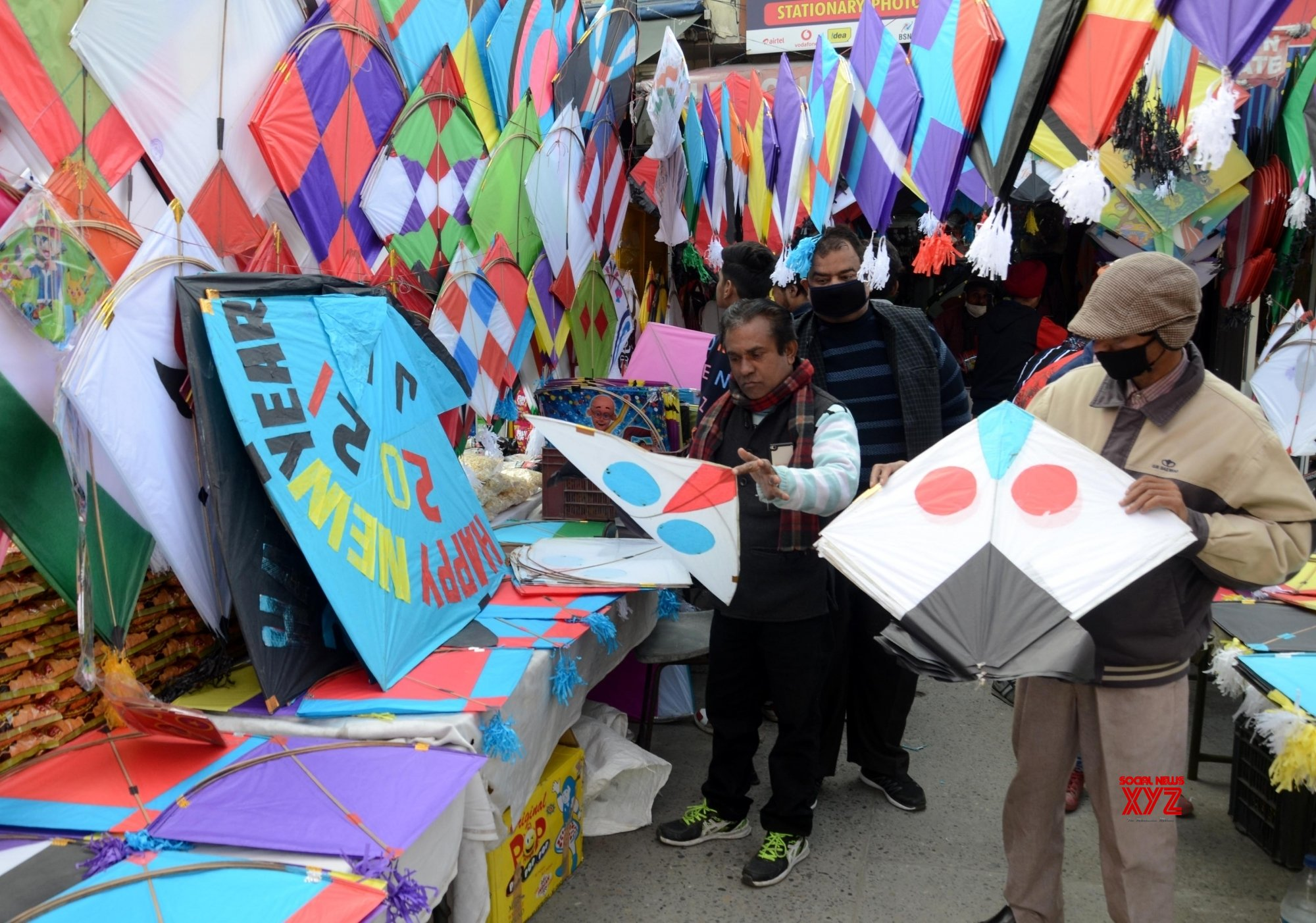 Amritsar: People shop for kites at a shop on the eve of Lohri festival in Amritsar, India, 12 January 2021. #Gallery