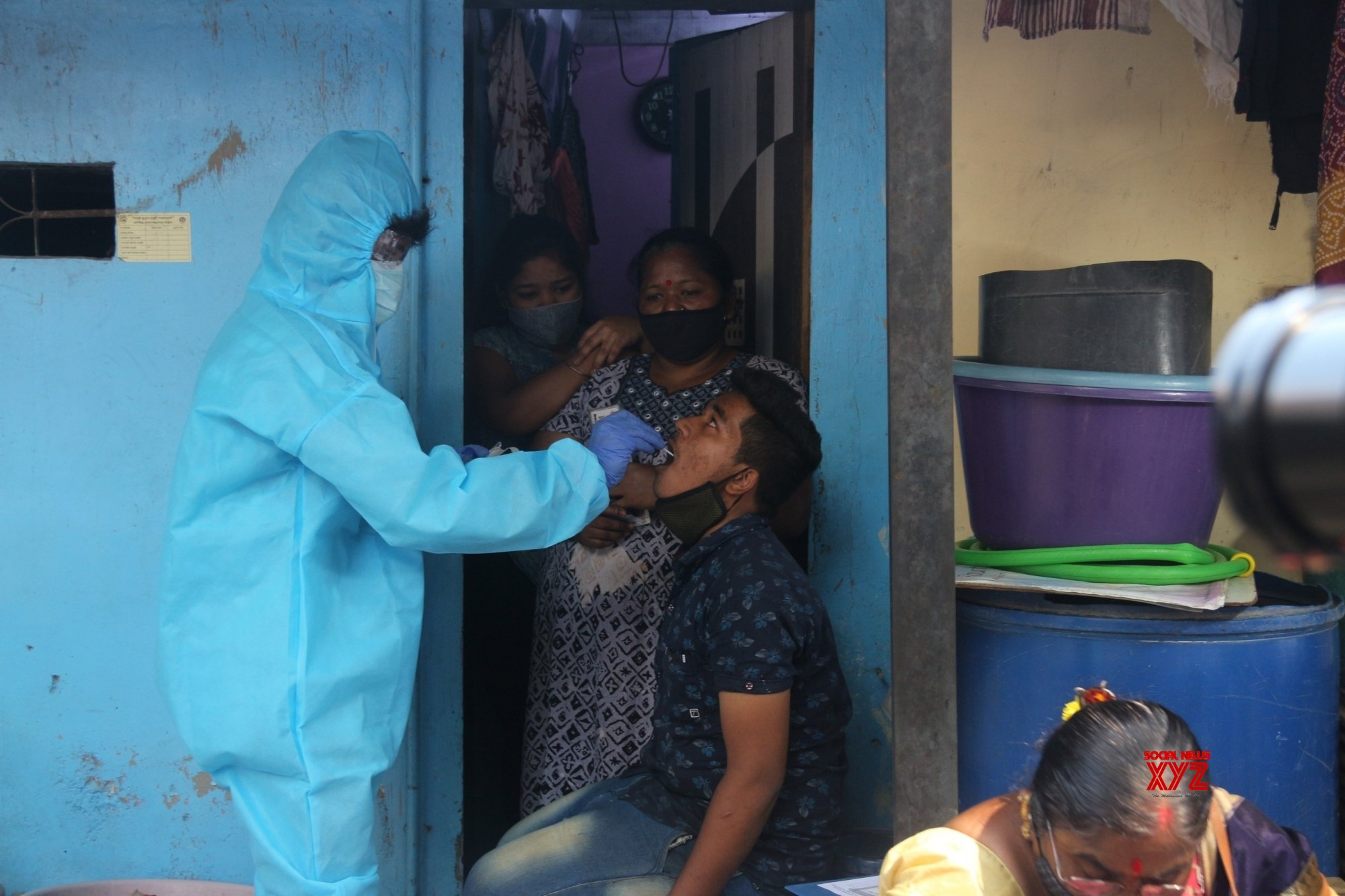 Mumbai: A health worker swab test of a resident for COVID - 19 following rise in coronavirus cases at Dharavi in Mumbai, Maharashtra on Tuesday 23rd February, 2021 #Gallery