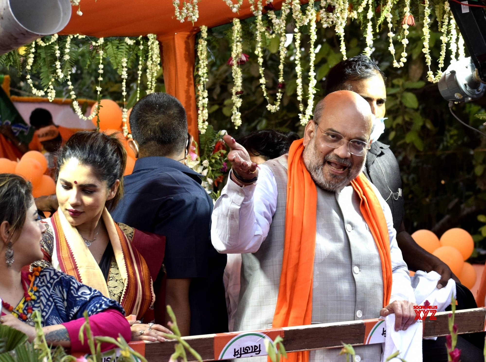 Kolkata :Indian Minister of Home Affairs Amit Shah at a road show in support of BJP candidates Babul Supriyo, Payal Sarkar, Srabanti Chatterjee for State Assembly election in Kolkata on April 7, 2021. #Gallery