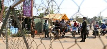 Cambodia: Police block a road on the border of Kampong Speu province and Kandal province in Cambodia to prevent inter-provincial travel on April 7, 2021.  (Photo by Ly Lay/Xinhua)