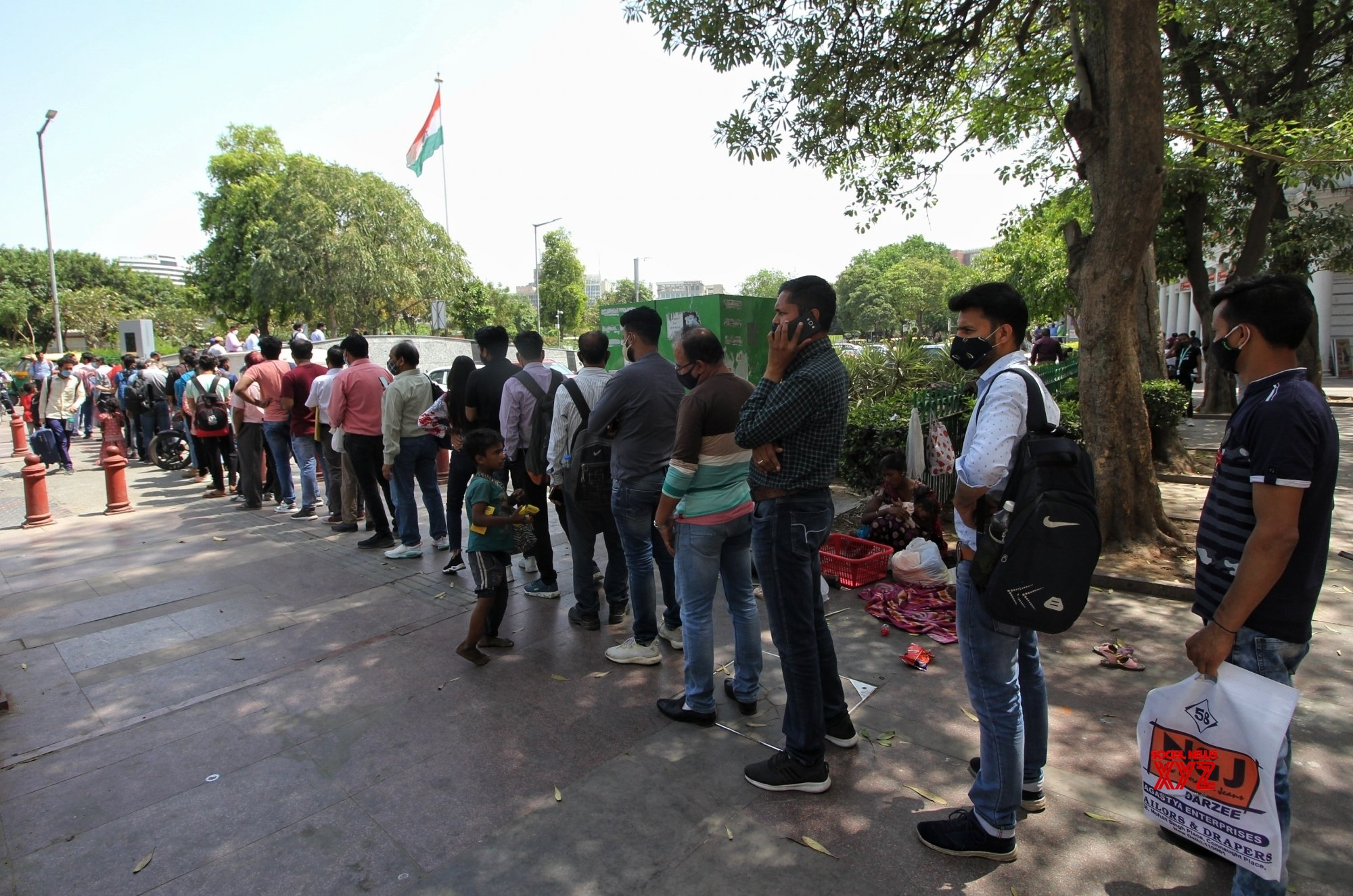 People stand in a long que for enter the Rajiv Chowk Metro station due to Covid - 19 restrictions, station entry gate are closed only gate no 8. #Gallery
