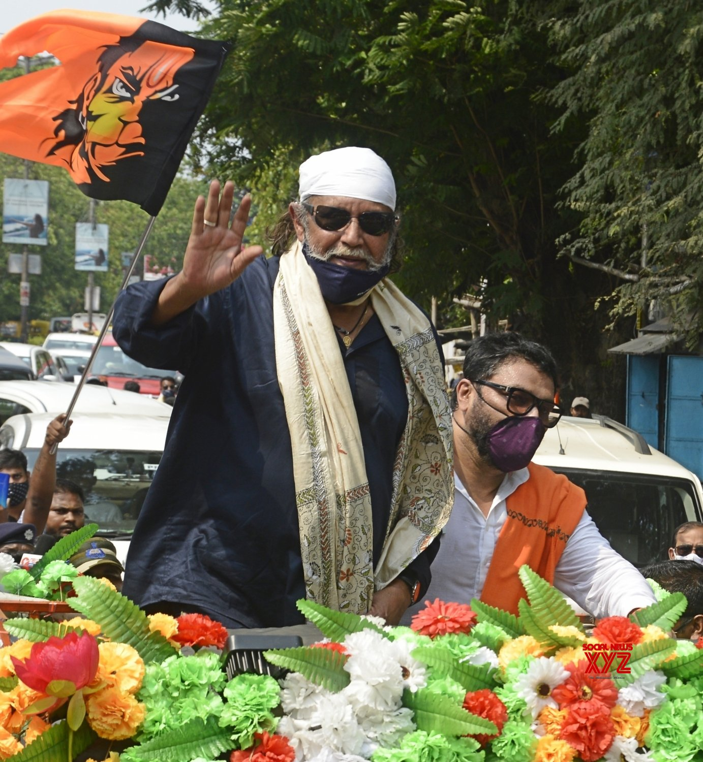 Kolkata : Actor turned BJP leader Mithun Chakraborty along with BJP candidate for Tollygunge constituency, Union Minister of State for Environment, Forest and Climate Change, Babul Supriyo at a roadshow during campaigning for the State Assembly election in Kolkata on April 8, 2021. #Gallery
