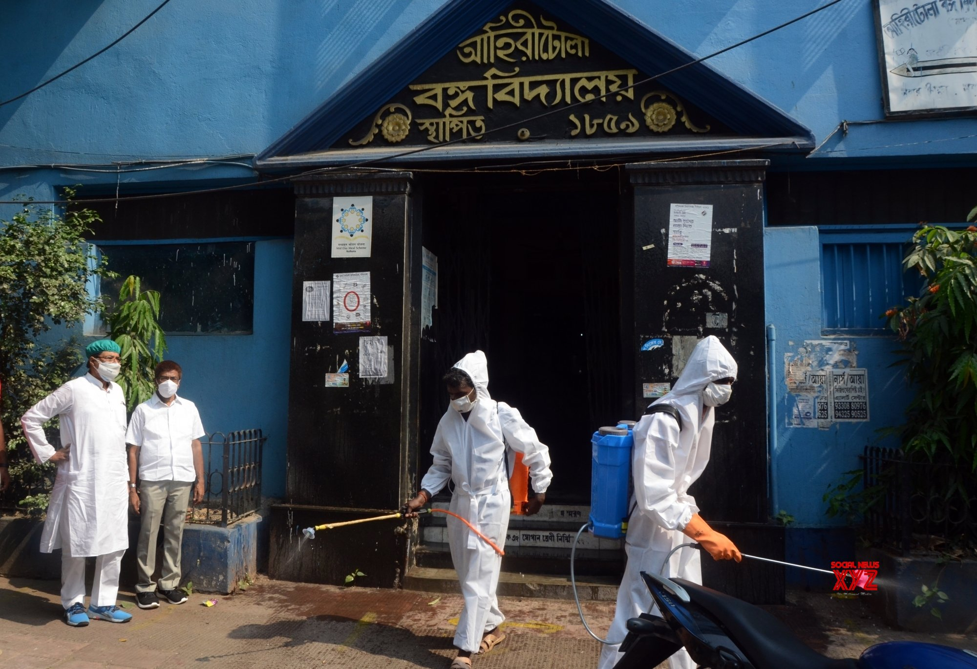 Kolkata : Health workers sanitize polling station ahead of the last phase of State Assembly election #Gallery