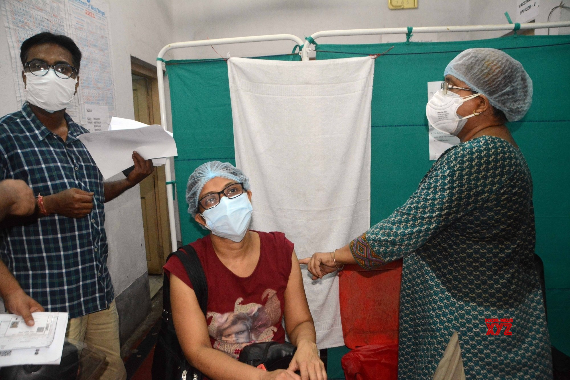 Kolkata: Health workers give the 1st dose of vaccine to the Government workers - during increasing numbers of COVID 19 cases - in Kolkata. #Gallery