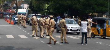 Hyderabad :  Hyderabad police  implementing the lockdown across twin cities with top cops in the capital region warning people that any unwanted movement on the roads after 10 am would be dealt with strictly and vehicle seized  Monday  in Hyderabad 24 May 2021.  (Photo: IANS)