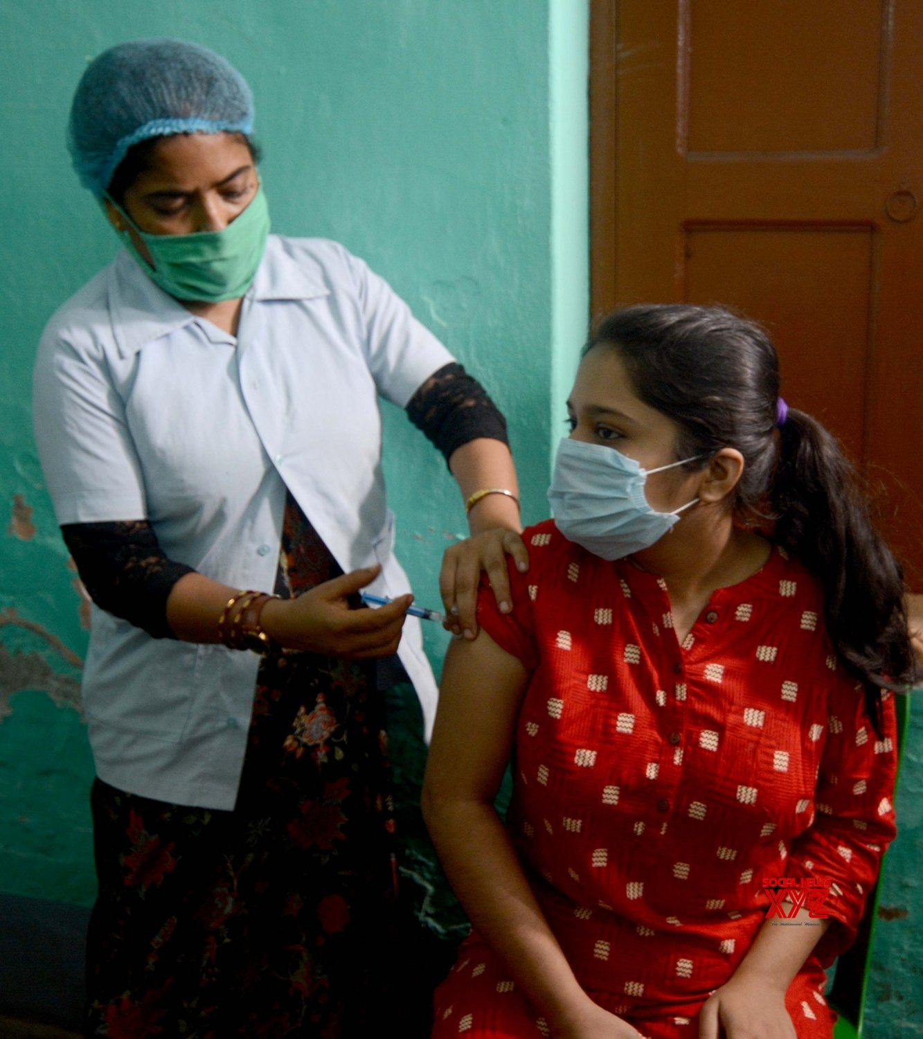 Kolkata: Health workers are giving the vaccine to the local people at Rajarhat Gopalpur area during increasing numbers of COVID 19 cases near in Kolkata. #Gallery