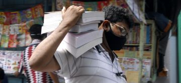 Kolkata:  Customers purchase books from book stalls at College street Book market after authority restricted permissions of Covid 19 in Kolkata on Tuesday 08 June, 2021. (Photo: Kuntal Chakrabarty/ IANS)