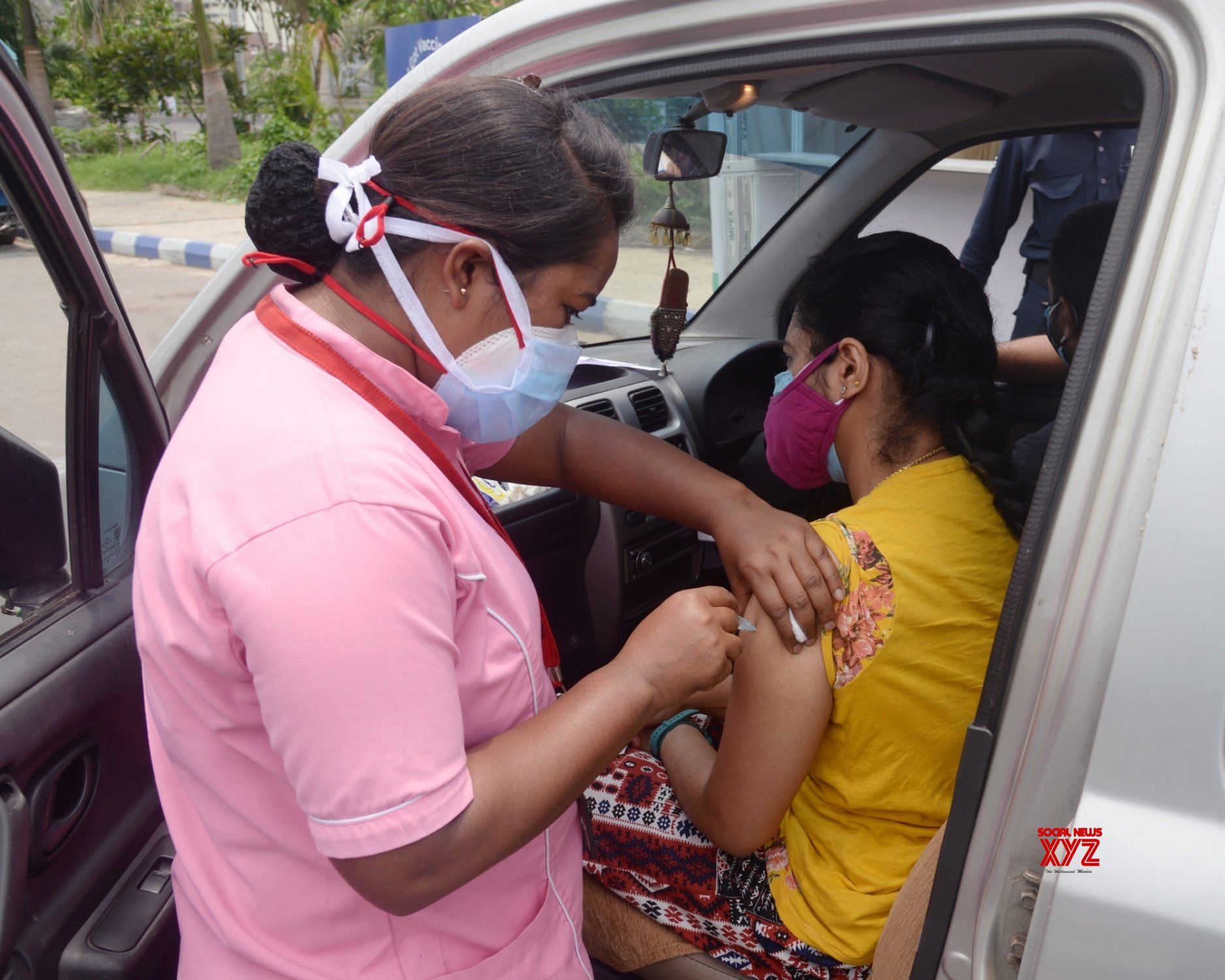 Kolkata: Medic administers dose of COVID - 19 vaccine to a beneficiary during Drive through By Vaccination camp in Kolkata. #Gallery
