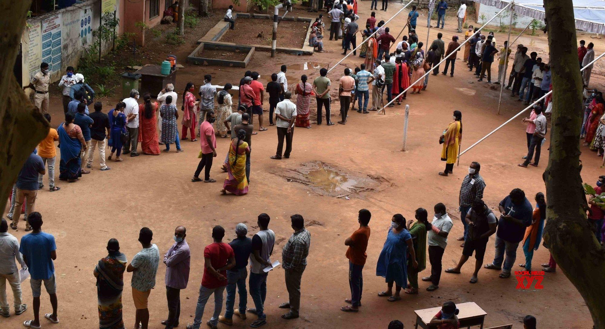 Hyderabad : People stand in a queue at - Govt. High school Musheerabad - to receive Covid 19 vaccine - in Hyderabad. #Gallery