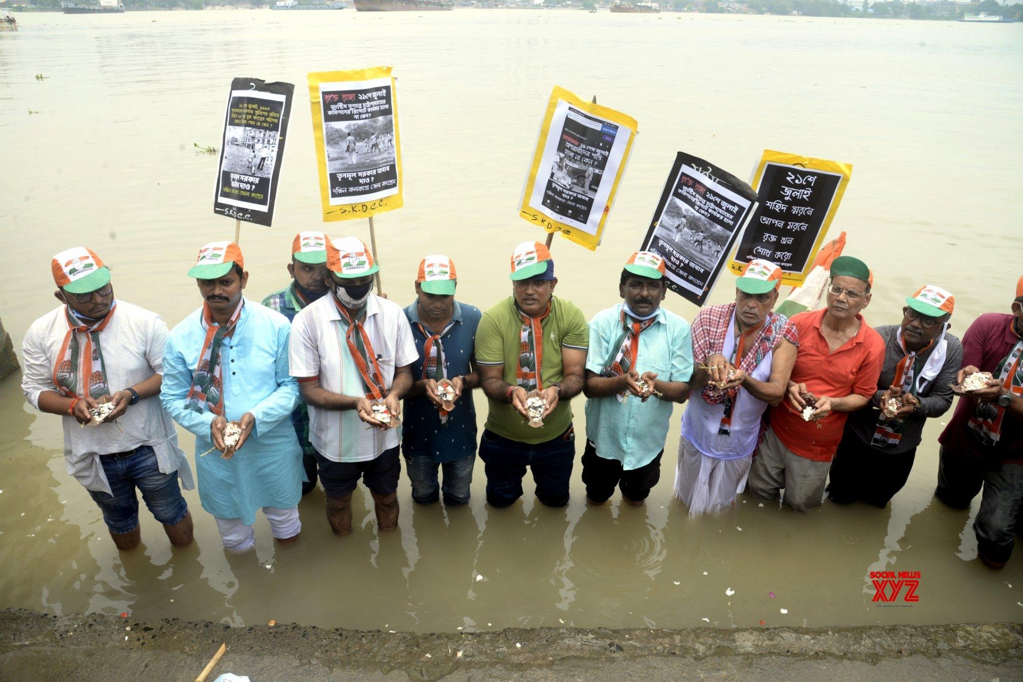 Kolkata: Youth Congress activists perform Tarpan ritual at River Ganga ghat in memory of youth Congress activists killed during July 21, 1993 protest rally in Kolkata #Gallery