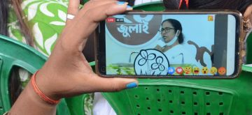 Kolkata: TMC supporters watching on big screen at various places in City, TMC supremo and West Bengal Chief Minister Mamata Banerjee's virtual meeting on the occasion of 21 July TMC Martyrs day observation in Kolkata on July 21 in 1993. (Photo: Kuntal Chakrabarty/IANS)