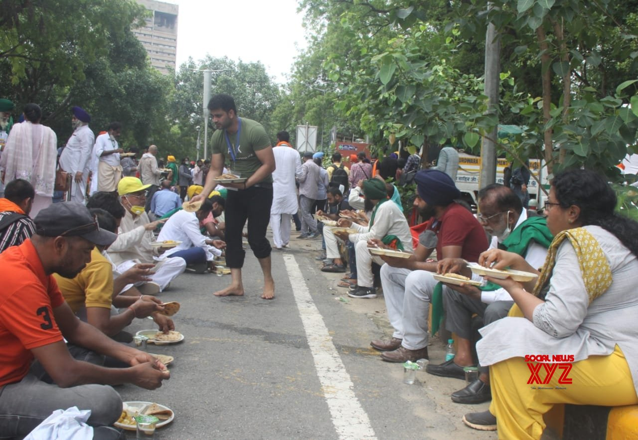 New Delhi: Farmers take lunch during their protest against three farm laws amid monsoon session of Parliament at Jantar Mantar in New Delhi. #Gallery