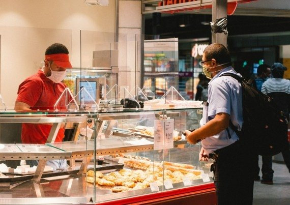 - A man wearing a mask buys food at a store in a railway station in Cologne, Germany, on July 16, 2020. #Gallery