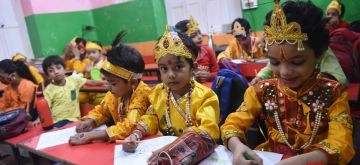 Patna: Students dressed as Lord Krishna at their school on the eve of Janmashtami celebrations in Patna on Saturday, August 28, 2021.(Photo: Indrajit Dey/IANS)
