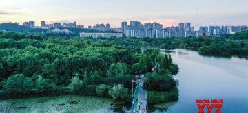 Aerial photo taken on July 7, 2021 shows citizens walking at Guanshanhu Park in Guiyang, capital of southwest China's Guizhou Province. (Xinhua/Yang Wenbin/IANS)