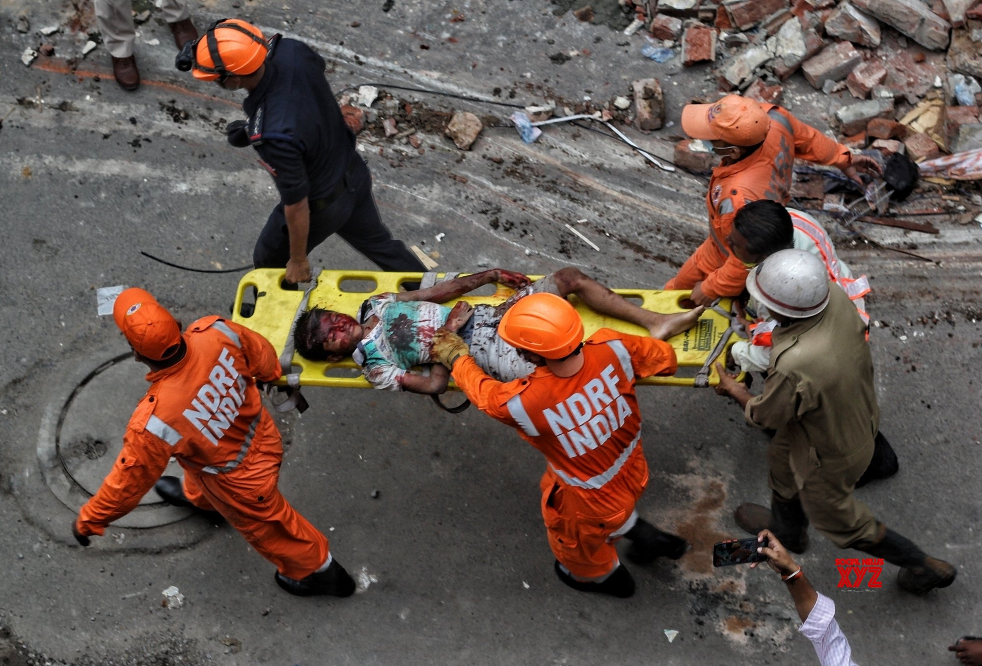 New Delhi : NDRF and Delhi Police personnel carried out a rescue operation after a four - storey building collapsed in Sabzi Mandi area, the main market in New Delhi #Gallery