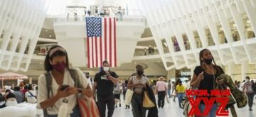 People walk inside the Oculus center in New York, the United States, Sept. 6, 2021. (Xinhua/Wang Ying/IANS)