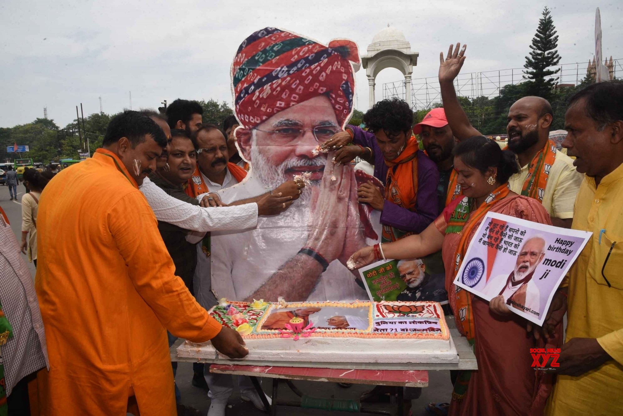Patna: BJP party workers offering cake on the photo of - Prime Minister  Narendra Modi, on the eve of his birthday - in - Patna. #Gallery - Social  News XYZ