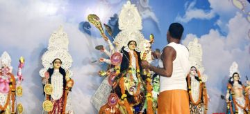 Ranchi: A Hindu Priest offers prayer to Goddess Durga on the eight day of Durga Puja Festival in Ranchi on Wednesday, October 13, 2021.(Photo: Rajesh Kumar/IANS)
