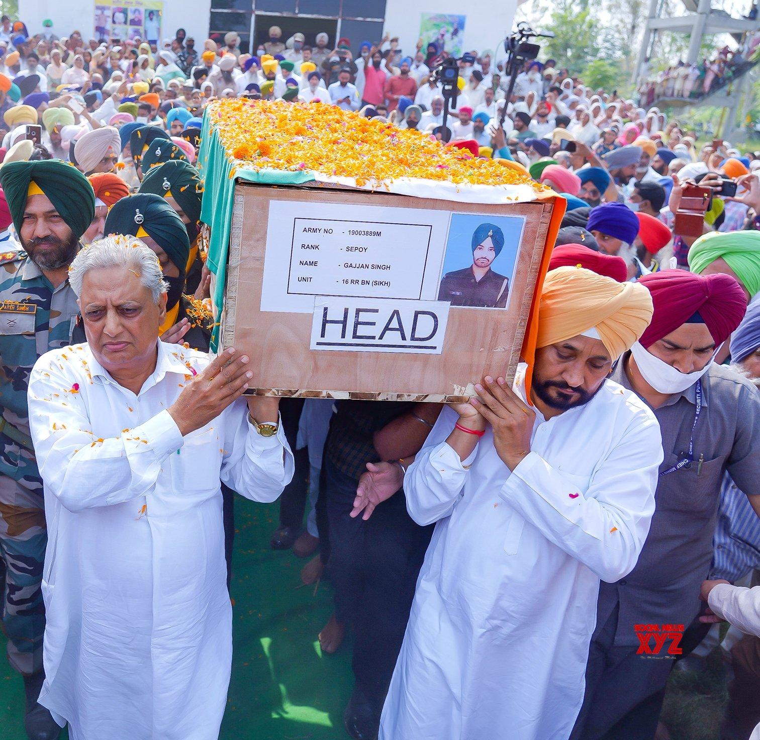 Amritsar:Punjab CM Charanjit Singh Channi participating in the funeral procession of Martyr Sepoy Gajjan Singh during his last rites at his native Village Pachranda,Nupur Bedi in Rupnagar District in Punjab #Gallery
