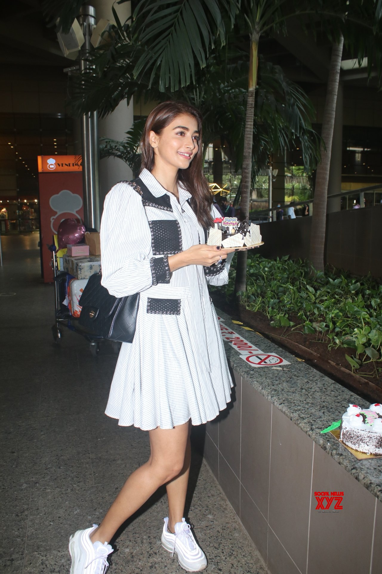 Actress Pooja Hegde Spotted At Airport Arrival And Cutting Birthday Cake With Media - Gallery