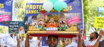 Ahmadabad :Members of International Society for Krishna Consciousness (ISKCON) protest against recent violence against Hindus in Bangladesh, in Ahmedabad, on Saturday, Oct. 23, 2021.(PHOTO:IANS/Siddharaj Solanki)