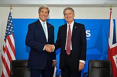 John Kerry and Philip Hammond prior to panel