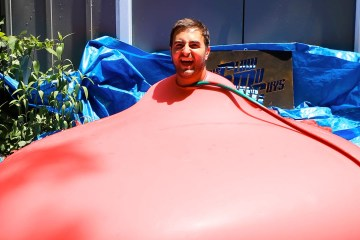 6ft-Man-in-6ft-Giant-Water-Balloon-4K-The-Slow-Mo-Guys