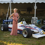 Elena posing with a Rothmans/Newsweek Formula One Race Car