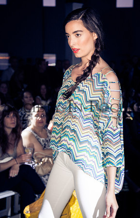Runway Model in Striped Top and White Pants