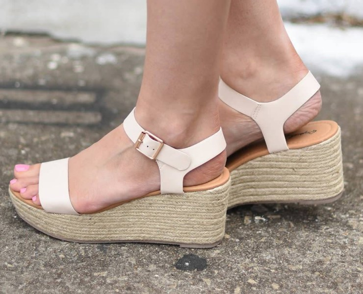 Are you in search of the cutest slip on wedges for this spring and summer season? We've rounded up the most comfortable and trendy wedge sandals to pair with a sun dress for brunch or skinny jeans for everyday street style.