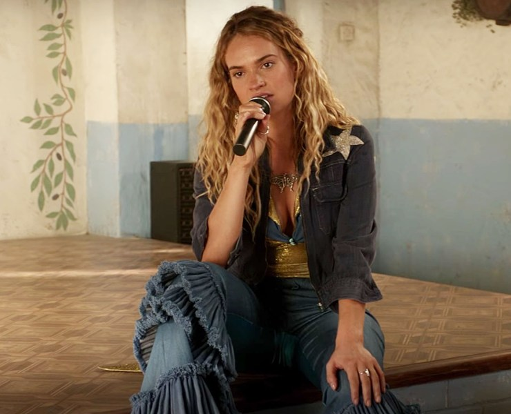 Lily James sports a colorful wardrobe with a wide range of outfits as young Donna in Mamma Mia 2. Here's how you can do the same!