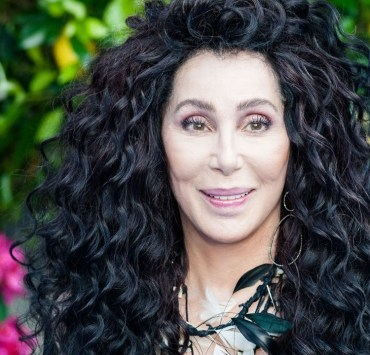 Cher's expansive career also means a litany of timeless Cher outfits that are totally unforgettable. But do you believe we can cut it down to just ten?